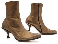 Clean-lined and chic, this gorgeous ankle boot rocks the world in either multicol Fab Shoes, Gold Leather, Beautiful Shoes, Antique Gold, Heeled Boots, High Heels, Booty, Antiques, Chic