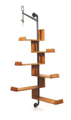 JACQUES HITIER (1917-1999)  Étagère d'angle formée d'éléments en frêne de lon