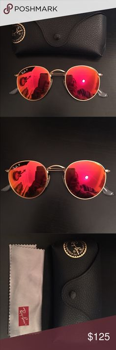 Ray Ban Polarized Round Orange Flash Sunglasses Ray Ban round, orange flash lens, gold metal trim, polarized sunglasses. Only worn once and in perfect condition. Ray-Ban Accessories Sunglasses