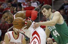 Houston Rockets center Dwight Howard (12) battles for the ball against Boston Celtics center Tyler Zeller (44) during the first half of an NBA basketball game at Toyota Center, Saturday, Nov. 1, 2014, in Houston. ( Karen Warren / Houston Chronicle  )