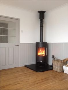 Farrow & Ball Purbeck Stone 275 - Woodwork painted in Purbeck Stone Corner Log Burner, Wood Burning Stove Corner, Corner Stove, Farmhouse Fireplace, Fireplace Hearth, Stove Fireplace, Fireplace Design, Fireplace Candles, Fireplace Stone