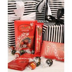 A delightful Lindt chocolate hamper containing chocolate balls, Creation Mousse, Les Grandes Hazelnut, Cote d'Or Mignonettes and Excellence chocolate slabs. Lindt Lindor, Lindt Chocolate, Gift Hampers, Gift Baskets, International Florist, Chocolate Hampers, I Love Books, Fathers Day Gifts, Mousse
