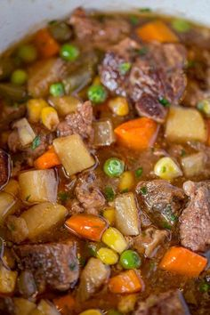 You'll want to dip crusty french bread in this AMAZING Slow Cooker Vegetable Beef Soup!