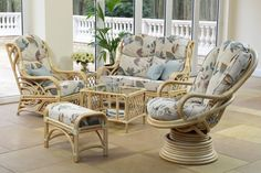Elegant cane conservatory furniture with cushions.