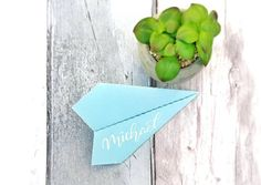 6 calligraphy paper aeroplane place cards for wedding tables, folded airplane design by TeaandBumble on Etsy Calligraphy Wedding Place Cards, Calligraphy Paper, Wedding Cards, Felt Christmas, Christmas Time, Airplane Wedding, Airplane Design, Wedding Places, Travel Themes