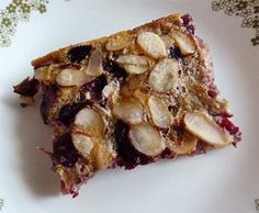 Slice of gluten-free cherry clafouti with sorghum flour on dessert plate, view from above.