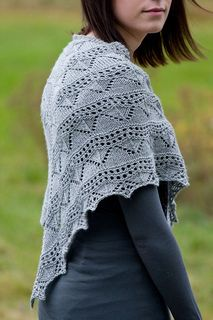 """Kuura (""""Frost"""" in Finnish) is a triangle shawl worked from back neck down. The shawl is made of two skeins of luscious merino-silk Silkbloom Fino. Adding or reducing lace pattern repeats you can make a small one-skein shawl with your favorite sock yarn or a large stole with lace yarn."""