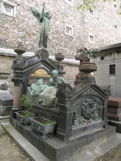 """""""The story he reads to her in bed will never end"""" Gothic tombstone - Montparnasse Cemetery"""