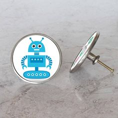 Children's Robot Furniture Door Knobs by Pushka Home, the perfect gift for Explore more unique gifts in our curated marketplace. Cupboard Door Knobs, Cupboard Drawers, Door Handles, Bathroom Light Pulls, Robots Characters, Wooden Bathroom, Quirky Home Decor, Robot Design, Furniture Knobs