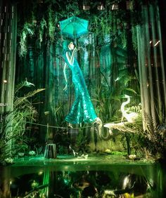 """BERGDORF GOODMAN, New York, """"The Scenic Lagoon"""", (A magical lagoon overgrown with cypress trees, orchirds and ferns, an fabulous adventurer walks a tightrope over a sealife beneath), for CD. Greene, pinned by Ton van der Veer"""
