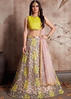 Get Yellow Lehenga for haldi and wedding ceremonies at Mirraw. Exclusive range of Yellow Lehenga Designs with lowest cost in USA, UK Lehenga Choli Designs, Net Lehenga, Bridal Lehenga Choli, Bollywood Lehenga, Ghagra Choli, Lehenga Blouse, Indian Lehenga, Indian Dresses, Indian Outfits
