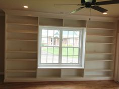 Built in shelves around a window. I would love to have something like this around my dining room window, only without the storage bench underneath the window.