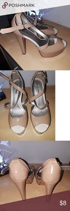 Nude Platform Heel Size 8 Cute platform and semi chunky heel.. cross strap shoe.. Super high 5 1/2 inches.. Good condition with no scuffs..   Thank you for checking out my closey and please check out my other listings for more clothes, shoes and accessories.. Michael Antonio Shoes Heels