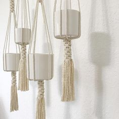 """The Filament Plant Hanger is part of our West Elm collection. Materials: 100% Recycled Cotton Cord + Metal ring Approx. measures: 43""""l. Accommodates a 4-9diam. plant holder; planter not included. Perfect to add a modern touch to any room of your home, office or creative space."""