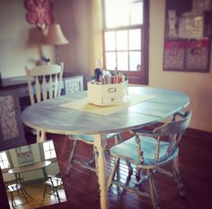 Goodwill thrift store 12.50 table with 2 chairs I painted and put in the craftroom