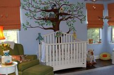 One of my absolute favorites - great use of orange in this baby room!