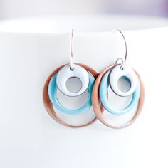 These medium sized copper enamel earrings are three hoops that dangle from my own sterling silver ear wires. They are torch fire enameled in the colors of light gray, beige and a mint green which is my color blend called - Seafoam Shores. They are completely handmade with care