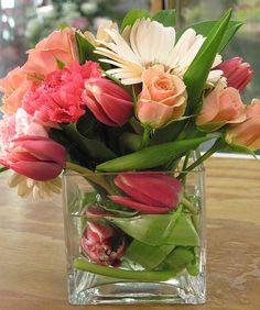 spring flowers in cube vase