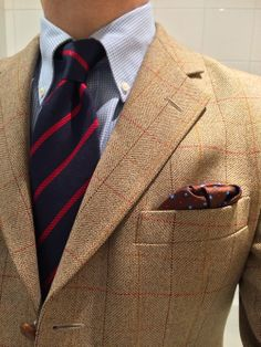 Beige tweed jacket red windowpane plaid, white shirt with light blue min check, navy tie with red stripes