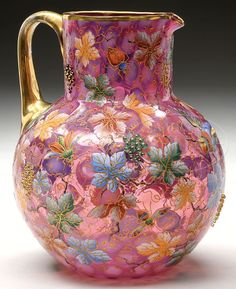Moser Opalescent Decorated Cranberry Glass Pitcher Has Opalescent Coin Spot Pattern And Is Decorated With Allover Brightly Enameled Grape Leaves And Gilded Vines With Applied Beaded Grapes, Three Dimensional Applied Birds And Numerous Enameled Insects, Finished With A Gilded Applied Glass Handle - via James D. Julia, Inc. Auctioneers.