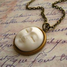 Bone Moon Face and Antique Brass Necklace di NestingNomad su Etsy