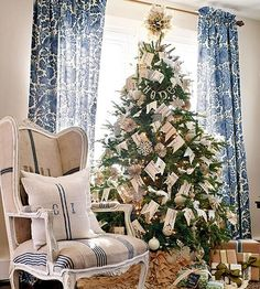 Homemade pennant banners give this elegant Christmas tree a cute, crafty look. Making the banners all in cream tones keeps the look streamlined: http://www.bhg.com/christmas/trees/christmas-tree-pictures/?socsrc=bhgpin112114bannerchristmastree&page=4