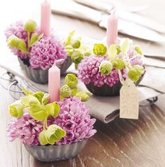 <3 - vintage tin molds, flowers, candle - sweet, simple and inexpensive centerpiece or favor.