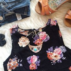 ✨HP✨ Floral Crop Top Black floral crop top from ShopRuche. Never worn, perfect for summer! Size medium but fits more like S/XS. Listing is only for crop top, other items are only being used for display. Host Pick | Spring Fling Party | 03-07-16 ShopRuche Tops Crop Tops