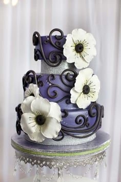 """Cake by Where Did You Get That Cake in Regina From the designer: """"My cake is designed for the non-traditional bride that is not afraid to stand out with a unique and bold cake. I was inspired by one of my favorite flowers, the anemone. They represent anticipation, which is a huge part of any wedding. Being such a delicate, elegant flower, I wanted them to stand out. Hand made with gum paste in bright white with a flash of lime green, they really pop against the purple. My cake was ..."""