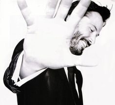 Keanu Reeves -damn that smile gets me every time....my ex-husband looked like Keanu but I didn't really notice it at first...probably the only reason why I stayed with that fool for so long