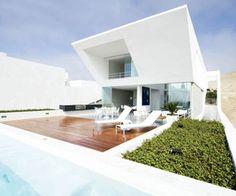 Sculptural Coastal Desert Vacation House by RRMR Arquitectos