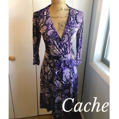 "⚡️CACHE WRAP DRESS⚡️ Like new CACHE snakeskin print purple wrap dress. Unwraps all the way. Gold hardware. 3/4 length sleeves. Size small. 94% polyester 6% spandex. Measures approx. 30.5"" inches from underarm to bottom. Excellent condition! Cache Dresses"