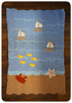 Summer Ocean Views baby blanket: The beach, waves and sailboats, with friendly fishies and a crab!