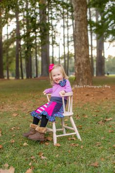 Look at this beautiful girl! She is one of the three TRIPLETS! This chair was so perfect for their outdoor family photo session at Black Creek Park!