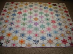 My very favorite Quilt. A beautiful vintage six point star. It looks like new and is so soft.