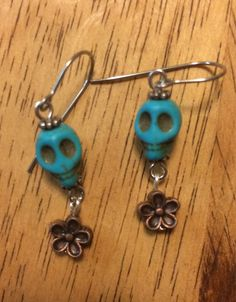 Do you need a little calavera in your life? How about two? This precious pair of turquoise skulls are perfectly paired with two little copper