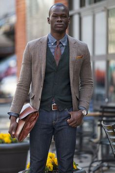 Thin Brown Tweed Blazer, black Sweater Vest, Chambray Shirt, and Cognac Leather Accesories. Men's Fall Winter Street Style Fashion.