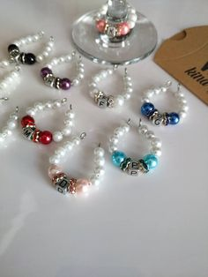 Personalized Wine Charm Rings Set of 10 Wine Charm Rings Wine Glass Markers, Wine Glass Crafts, Wine Bottle Crafts, Wine Ring, Bride Wine Glass, Beaded Napkin Rings, Beads And Wire, Pearl Beads, Wine Tags