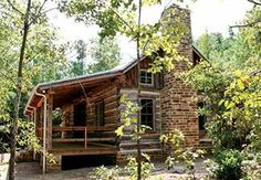 The new construction in the restored dogtrot log home contrasts with the weathered live oak logs of the original pens. Photos: Stephanie M. Chambers, Stephen B. Chambers Architects, Inc. See more at: http://chambersarchitects.com/smith-county-dogtrot.html