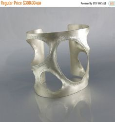 This gorgeous bold, statement cuff is one of a kind! It is a true show stopper.  This adjustable cuff is molded into curvy contours, then