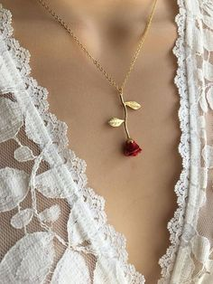 Original Red Rose Necklace, Beauty and the Beast Necklace,Anniversary Gift, Personalized Bridesmaid gift, Initial Necklace This dainty Long Stemmed Red Rose Necklace is plated in 24kt gold. Hand enameled. Personalized with tiny 16kt Gold plated rose leaf charms that are hand stamped
