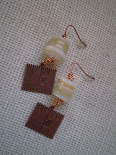 Items similar to Novelty Sewing Themed Earrings Featuring Vintage Buttons & Copper Measuring Tape Charm - upcycled,ivory buttons,stocking stuffer,budget gift on Etsy Look What I Made, Tape Measure, Brass, Charmed, Buttons, Drop Earrings, Trending Outfits, Unique Jewelry, Handmade Gifts