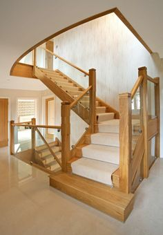This modern staircase is both natural and industrial, mixing natural wood treads with a carpet runner held in place with metal fixtures. The staircase spans multiple levels of the home. Luxury Staircase, Modern Staircase, Staircase Design, Staircase Pictures, Stair Design, Staircase Ideas, Wooden Staircases, Wooden Stairs, Painted Stairs