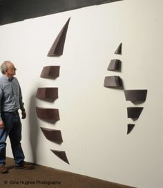"""Sirocco"" and ""Twister"" wall mounted ceramic sculptures by Mark Hilde."
