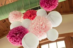 In decorating for a bridal shower, decorate with clustered paper decorations - paper lanterns, tissue papers and accordion lanterns is a lovely combination!