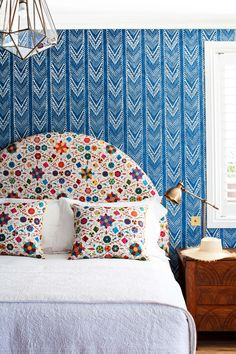 A bright mix of fabric patterns on headboard and walls at Halcyon House a boutique hotel in Cabarita Beach, Australia, designed by Anna Spiro | Remodelista