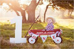 little boy and his red wagon | 1 year birthday shoot | radio flyer wagon | www.creativeclicksphoto.com