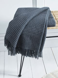 Lightweight and super soft, our exquisite basket weave throw is handcrafted in Denmark from pure alpaca wool, with a Scandinavian design that will look beautiful folded or draped in your home. Alpaca wool is measurably smoother than other natural fibres, and has no lanolin content, which together with its softness makes it perfect for sensitive skin. Also available in grey, green and blue.