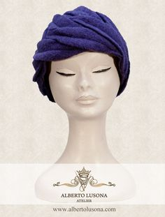 Alberto Lusona Fall/Winter Collection 2013 - Blue boiled wool hat in retro style decorated with leafs in the same material. $120 #albertolusona #boiledwool #eleganthat #retrostyle #clochehat