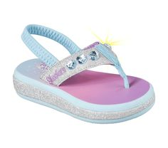 Give her some way cool style for the warm weather days with the SKECHERS Twinkle Toes: Sunshines sandal.  Soft glitter finish fabric upper in a flip flop casual thong sandal with light up gem detail and comfort sole.